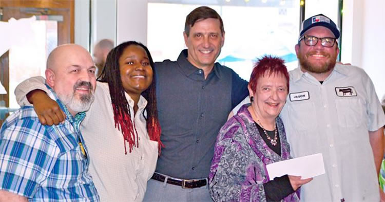 Chef Jason Alley, far right, presents a check to Diversity Richmond board chair Beth Marschak, with board members (R-L) Art Toth, Crystal Suber and Ray Green.